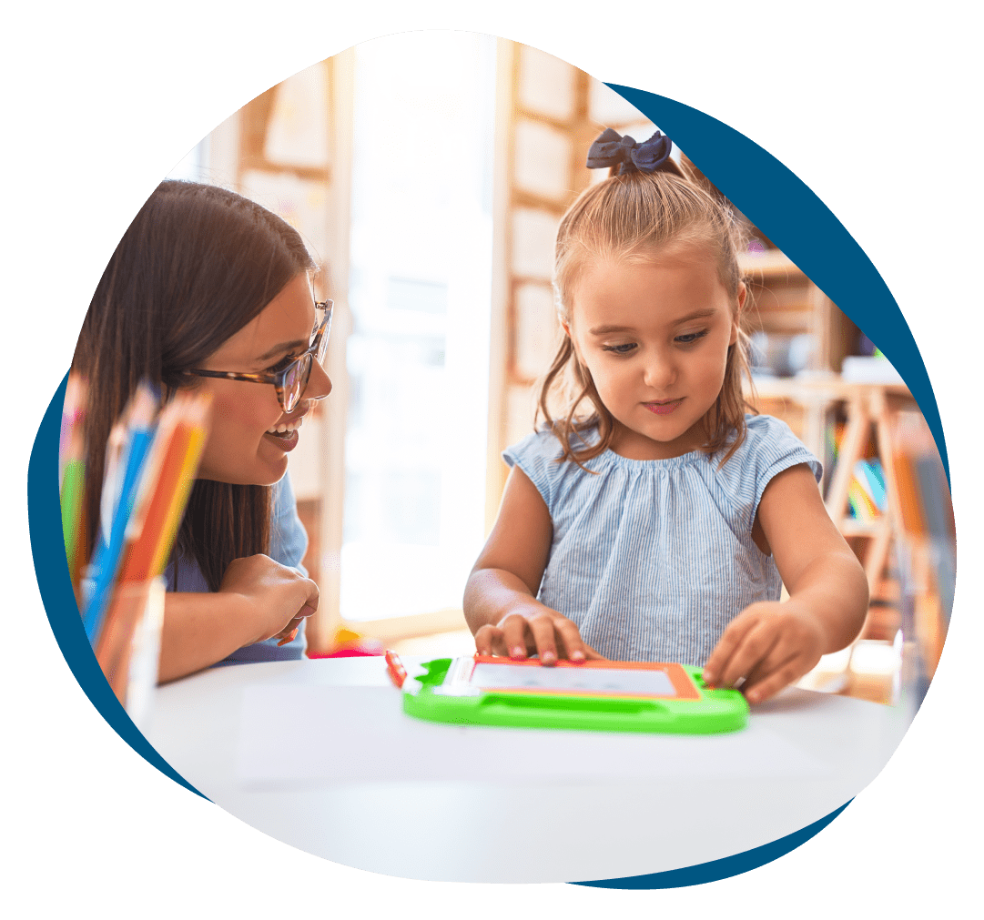 girl kid playing and learning at playschool with female teacher-Elevation Autism